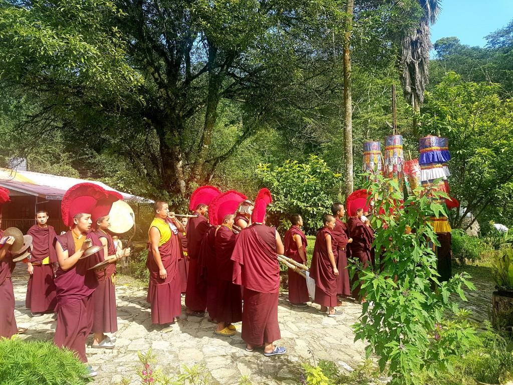 The monks pass through our farm house